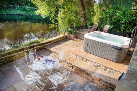 A hot tub with amazing views of the river